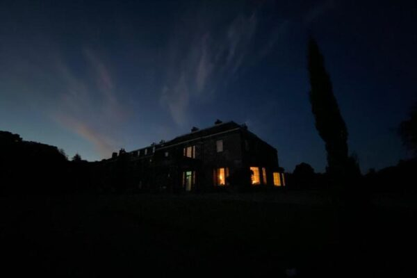 The Mansion House outlined in the evening sky with windows lit